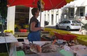 Fisherwoman selling fish at a stall
